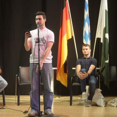 Youssef presenting his poetry – July 2015