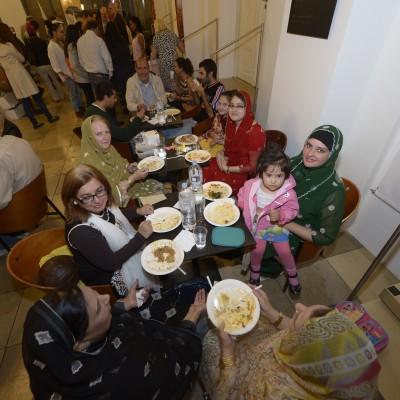 Pakistani women enjoying the Pakistani food at the Iftar dinner – July 2015