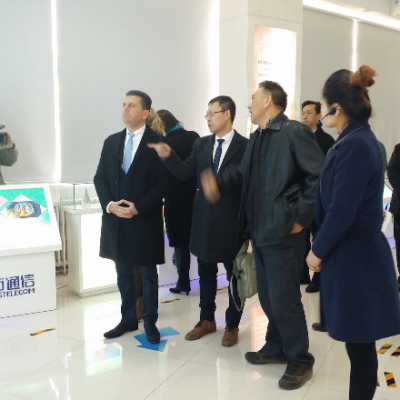 Consul Dr. Poetis being welcomed by Yonglu Zhang, Director and CEO, Sifang Telecom in Gaocheng Industry Park.