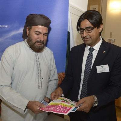 """Mr. Murad Mehmood from Honorary Consulate explaining Mr. Haji Mehmood about the """"Lange Nacht der Konsulate"""" – July 2015"""